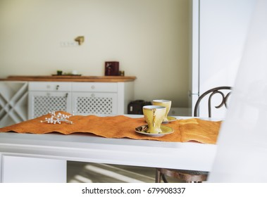 Cups of coffee on the table in beautiful white designe apartment