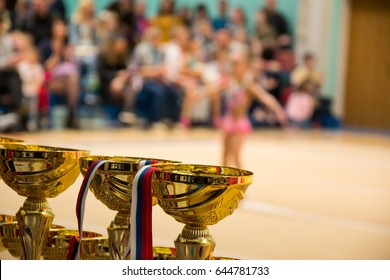 Cups in gymnastics competitions with blurred background