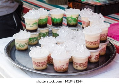 Cups of homemade pudding selling at the market stall.