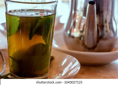 Cups of Moroccan mint tea served in small glass cups.
