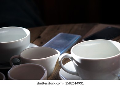 Cups on a wooden table