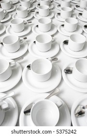 Cups and saucers arranged in the rows