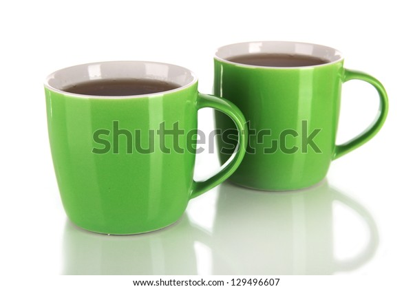 Cups of tea isolated on white