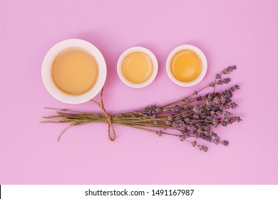 Cups of tea near flowers. Isolated on a colorful background.