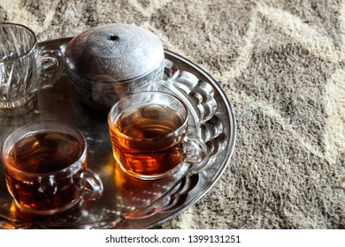 Cups of tea in nomads village Iran