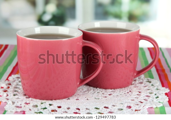 Cups of tea on table in room