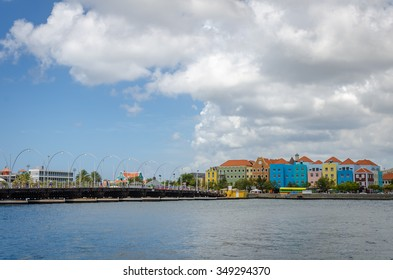 Curacao, Caribbean - September, 29, 2012: Willemstad, Curacao - Handelskade with colorful facades and Queen Emma Bridge