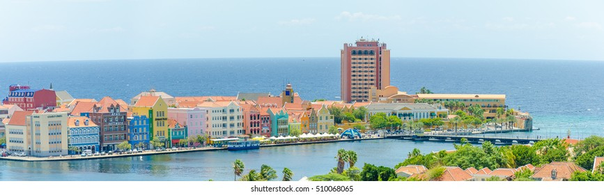 Curacao, Caribbean - September 29, 2012: Panorama view of  Willemstad  downtown with colorful facades in Handelskade Curacao, Netherlands Antilles