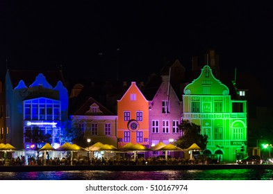 Curacao, Caribbean - September, 29, 2012: Willemstad at Night, Curacao. Handelskade with neon colorful facades