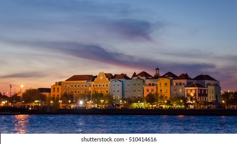 Curacao, Caribbean - September, 29, 2012: Willemstad sunset in Curacao with night lights. Handelskade with colorful facades