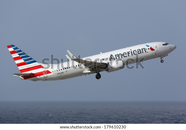CURACAO - FEBRUARY 16: An American Airlines Boeing 737 taking off on February 16, 2014 in Curacao. American Airlines is the world's largest airline with 619 aircraft and 108 million passengers.
