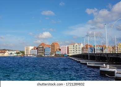 Curacao-11/3/19: Colorful pastel buildings on the water in the island of Curacao near the Queen Emma bridge.