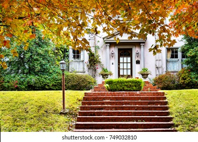 Curb Appeal - Charming home with red brick steps and fall foliage
