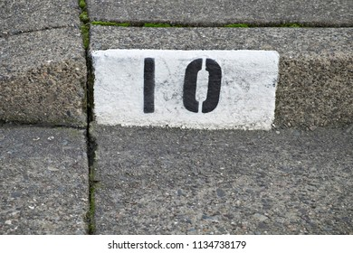 Curb Painted with Number Ten