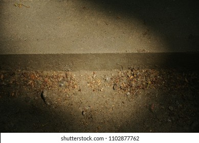 curb in the shade with a sunspot