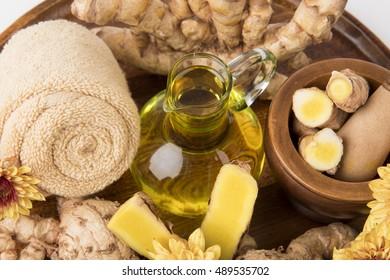 Curcuma aurantiaca Van Zijp., Rhizomes and herbal oils for massage therapy.