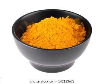 curcuma powder on a ceramic bowl (isolated on white background)