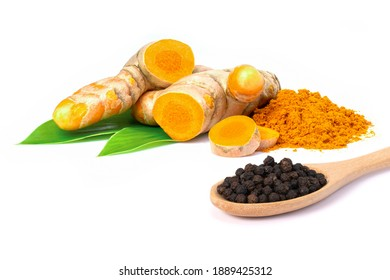 Curcumin powder ( tumeric ground, turmeric, Curcuma ) in wooden bowl and black pepper corn isolated on white background.