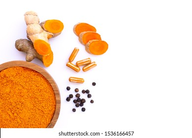 Curcumin powder, Turmeric root with sliced, Curcuma capsules and black pepper corn isolated on white background. Health benefits and antioxidant food concept. Top view. Flat lay.