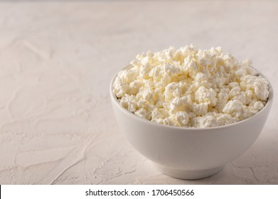 Curd in a bowl close-up on a light background