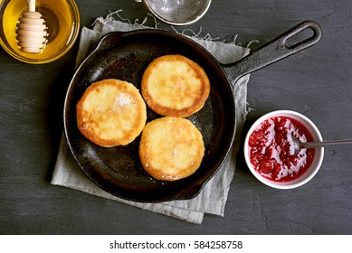 Curd cheese pancakes, cheesecakes in frying pan, top view