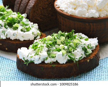 Curd sandwiches with fresh herbs. Fresh rye bread with cottage cheese and green herbs. Concept proper snack.