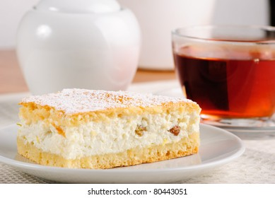 Curds shortbread with tea and sugar bowl on the table