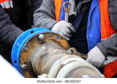 Cure for damaged pipes. Workers install a cured-in-place pipe (CIPP) renewal systems