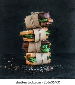 Cured chicken and spinach whole grain sandwich tower with spices and black stone background