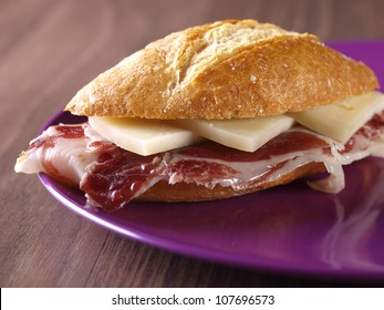 Cured ham and cheese sandwich. Typical spanish sandwich made with cured ham, cheese and baguette bread.