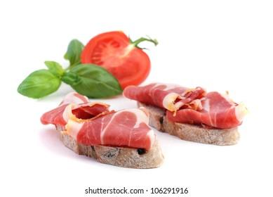 Cured ham iberico tapa, spanish appetizer, on white background isolated