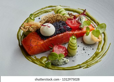 cured or smoked salmon wit caviar, cucumber sand sauces