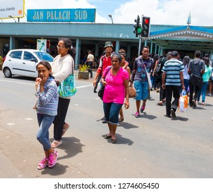 Curepipe / Mauritius Island - 28. October, 2018: Many young people walking on pedestrian crossing. Jan Palach bus station named on honor of Czech student hero who burnt to death in 19.january 1969.
