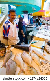 Curepipe / Mauritius Island - 28. October, 2018: Unidentified native fisherman selling his fish catch on traditional city market.