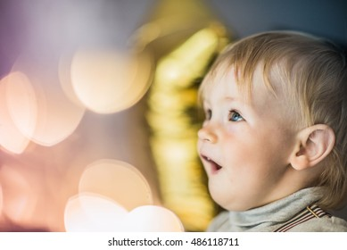 Curiosity, delight, wonder and joy on face - baby boy look in camera and smiling. He is so happy.