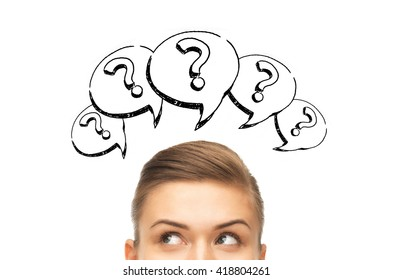 curiosity, information, knowledge, education and people concept - happy young woman or teenage girl head with question marks