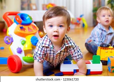 curious baby boy studying nursery room