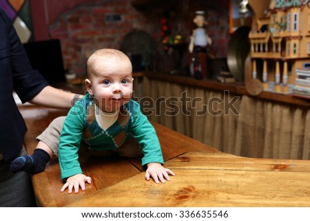 The curious baby crawling on the bar