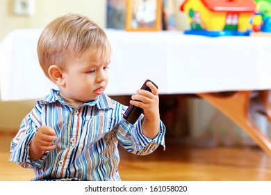 curious baby toddler exploring mobile phone