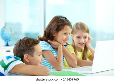 Curious friends watching some interesting stuff on the laptop