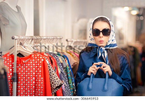 Curious Girl in Blue Trench Coat and Sunglasses Shopping - Surprised retro young woman in a raincoat in a clothing store
