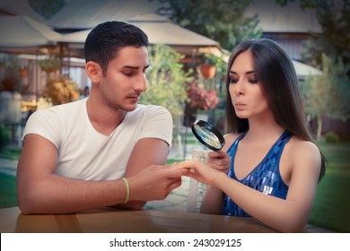 Curious Girl Testing Engagement Ring from Boyfriend with Magnifier - Young couple getting engaged in funny wedding proposal scene