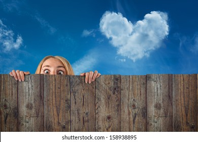 curious hide woman / girl, cloud  heart shape, blue sky background