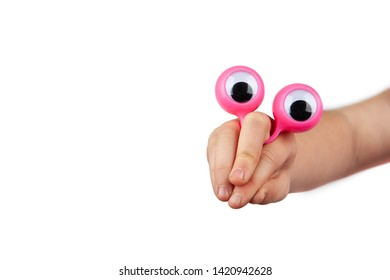 Curious and inquisitive funny face made with child hand and googly eyes isolated on white background with copy space