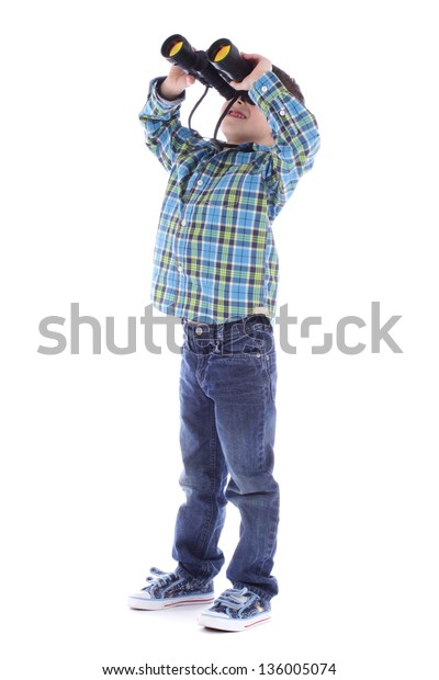 Curious little boy is looking through binoculars isolated over white background.