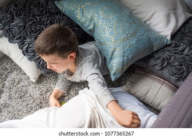 Curious little boy lying on bed