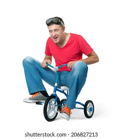 The curious man on a children's bicycle, on white background. File contains a path to isolation.