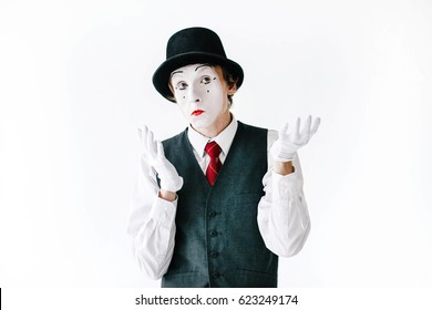 Curious mime holds his hands up