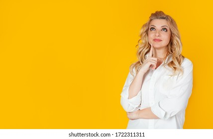 Curious modern stylish caucasian blond woman sideways look thinking make a choice thinking thinking delighted smile widely