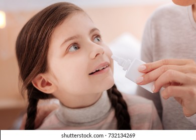 Curious recovering child with nasal drops